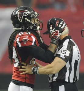 Dunta Robinson looks for something to hold onto while he and the Falcons defense weathered the Seahawks storming back in yesterday's divisional playoff game.